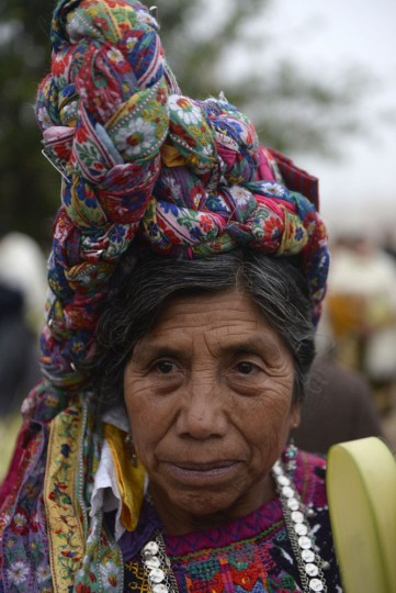 An indigenous woman prepares to take part in the Palm Sunday procession on March 29, 2015 in San Pedro Sacatepequez, 30 km west of Guatemala City. (Johan Ordonez/AFP/Getty Images)