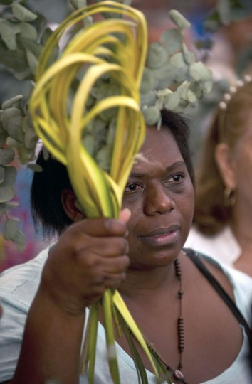 A faithful participates in a mass held as part of the Palm Sunday celebrations in Cali, Valle del Cauca department, Colombia, on March 29, 2015. (Luis Robayo/AFP/Getty Images)