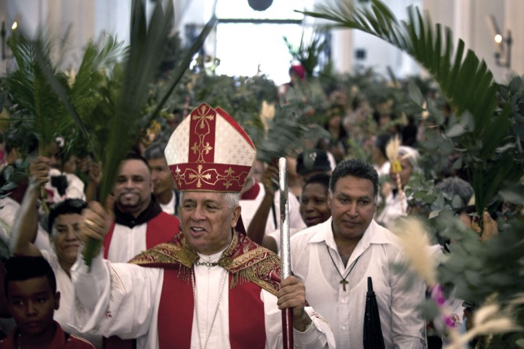 Monsignor Dario de Jesus Monsalve enters the church during the procession of the Palm Sunday celebrations in Cali, Valle del Cauca department, Colombia, on March 29, 2015. (Luis Robayo/AFP/Getty Images)
