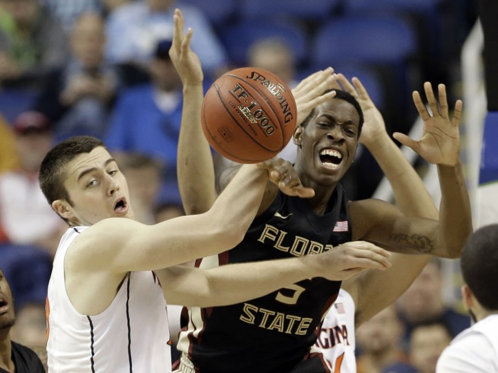 Virginia's Mike Tobey, left, and Florida State's Jarquez Smith, right, battle for a rebound during the second half of an NCAA college basketball game in the quarterfinals of the Atlantic Coast Conference tournament in Greensboro, N.C., Thursday, March 12, 2015. (AP Photo/Gerry Broome)