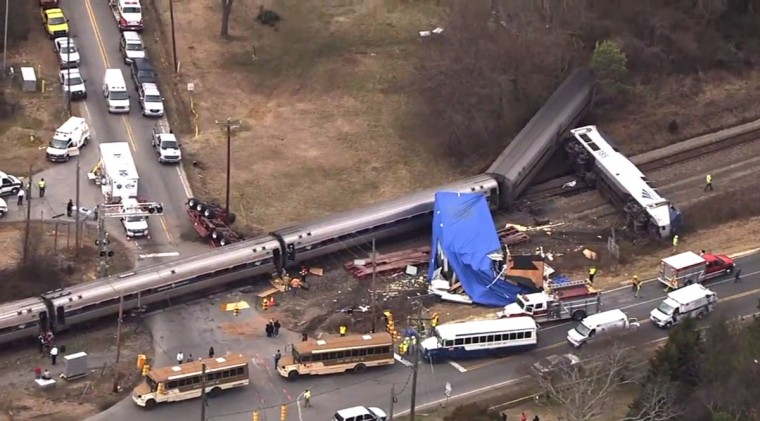 In this frame grab from video provided by WTVD-11, authorities respond to a collision between an Amtrak passenger train and a truck, Monday, March 9, 2015, in Halifax County, N.C. According to Halifax County Sheriff Wes Tripp, none of the injuries appeared to be life-threatening. (AP Photo/WTVD-11)