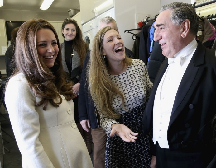 Britain's Kate Duchess of Cambridge, left, chats to actor Jim Carter, who portrays the butler Carson, during an official visit to the set of the TV series Downton Abbey at Ealing Studios in London Thursday March 12, 2015 . (AP Photo/Chris Jackson, Pool)