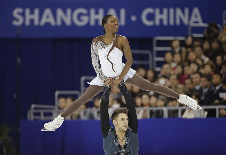 Vanessa James and Morgan Cipres of France perform during the Pairs Free Skating in the ISU World Figure Skating Championship 2015 held at the Oriental Sports Center in Shanghai, China, Thursday, March 26, 2015. (AP Photo/Ng Han Guan)