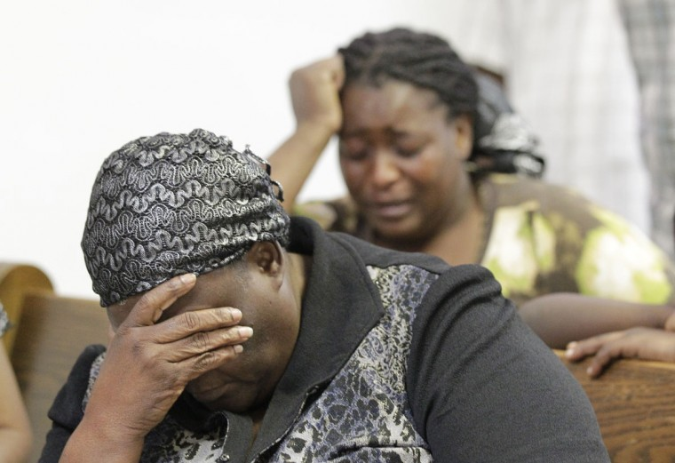 Members of the Independent Haitian Assembly of God pray at their church in Fort Pierce, Fla., Monday, March 30, 2015. Eight people were killed and 10 injured Monday when an overloaded van from the church ran through a stop sign, crossed all four lanes of a rural highway and crashed into in a canal. (AP Photo/Luis M. Alvarez)