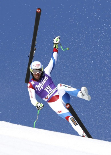 Carlo Janka, of Switzerland, loses his ski and crashes during the alpine ski, men's World Cup super-G race, at the World Cup finals in Meribel, France, Thursday, March 19, 2015. (AP Photo/Shinichiro Tanaka)