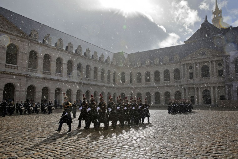 Republican Guards walk in the rain during a ceremony to welcome Quebec prime minister Philippe Couillard in the courtyard of the Invalides in Paris, Monday March 2, 2015. Philippe Couillard is on a five-day official visit in France. (AP Photo/Philippe Wojazer/Pool)