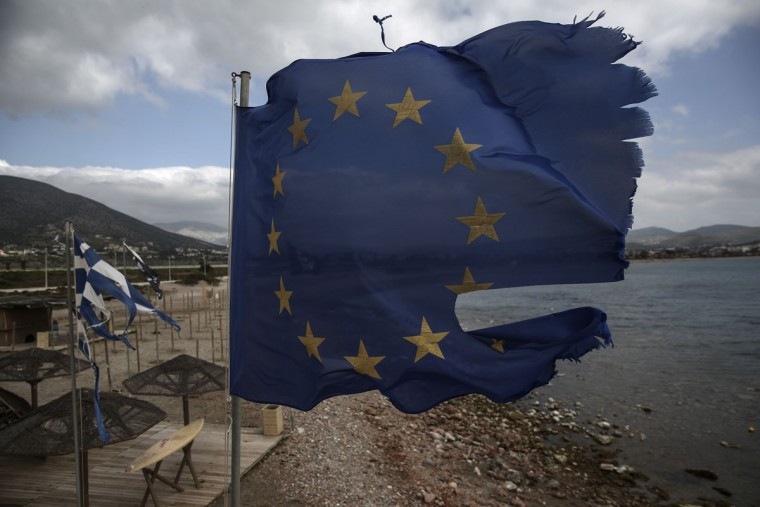 Ruined EU and Greek flags fly in tatters from a flag pole at a beach at Anavissos village, southwest of Athens, on Monday, March 16, 2015. Tensions between Greece, its eurozone partners and the institutions supervising the debt, the Commission, the European Central Bank and the IMF, have been heightened by the new government's continued election-style rhetoric and the EU's austerity demands. (AP Photo/Yorgos Karahalis)