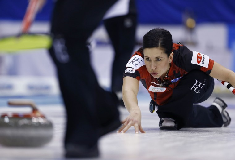 Canada's Jill Officer watches after releasing the stone as the team plays Switzerland during the second end of the final match of the women's World Curling Championships in Sapporo, northern Japan, Sunday, March 22, 2015. Canada was defeated by Switzerland 3-5. (AP Photo/Shizuo Kambayashi)