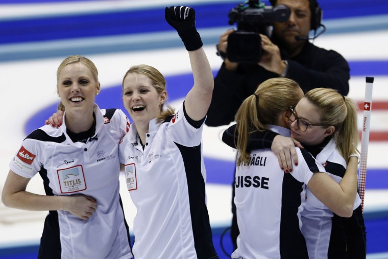 Swiss curlers, from left, Nadine Lehmann, Marisa Winkelhausen, Nicole Schwaegli and Alina Paetz celebrate after winning their final match against Canada at the World Women's Curling Championship in Sapporo, northern Japan, Sunday, March 22, 2015. Switzerland defeated Canada 5-3 and won the championship title. (AP Photo/Shizuo Kambayashi)