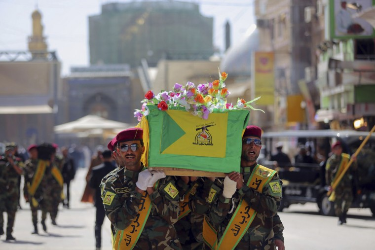Iraqi Hezbollah fighters carry the coffin of their comrade, Ali Mansour, who his family says was killed in Tikrit fighting Islamic militants, during his funeral procession, in the Shiite holy city of Najaf, 100 miles (160 kilometers) south of Baghdad, Iraq, Monday, March 2, 2015. Backed by allied Shiite and Sunni fighters, Iraqi security forces on Monday began a large-scale military operation to recapture Saddam Hussein's hometown from the Islamic State extremist group, state TV said, a major step in a campaign to reclaim a large swath of territory in northern Iraq controlled by the militants. (AP Photo/Jaber al-Helo)