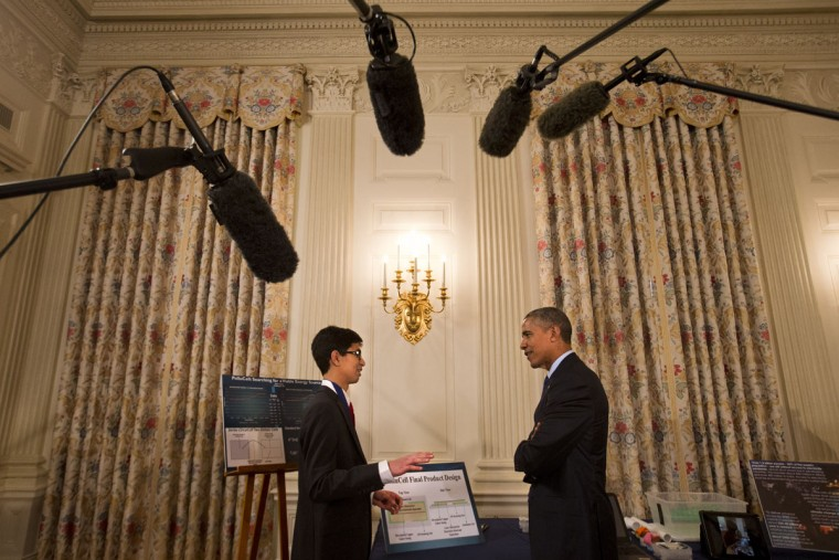 Sahil Doshi, 14, of Pittsburgh shows his carbon-dioxide powered battery idea to President Barack Obama during the president's tour of the White House Science Fair, Monday, March 23, 2015, at the White House in Washington. (AP Photo/Jacquelyn Martin)