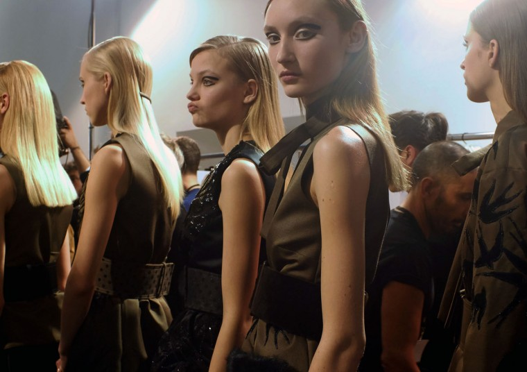Models wait backstage prior to Rochas ready-to-wear fall-winter 2015/2016 fashion collection as part of Paris Fashion Week in Paris, France, Wednesday, March 4, 2015. (AP Photo/Jacques Brinon)