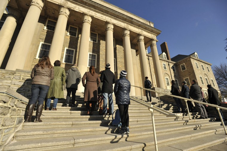 Protestors stand in silence against the Kappa Delta Rho fraternity, in front of Penn State University's Old Main building, in University Park, Pa., Monday, March 23, 2015. The fraternity is accused of posting photos of nude or partly nude women, some asleep or passed out, on an invitation-only Facebook page. (AP Photo/Centre Daily Times, Nabil K. Mark)
