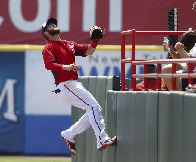 Washington Nationals right fielder Bryce Harper (34) chases a foul ball from Detroit Tigers' Hernan Perez in the fourth inning of an exhibition spring training baseball game Thursday, March 19, 2015, in Viera, Fla. Harper had no play. (AP Photo/John Bazemore)