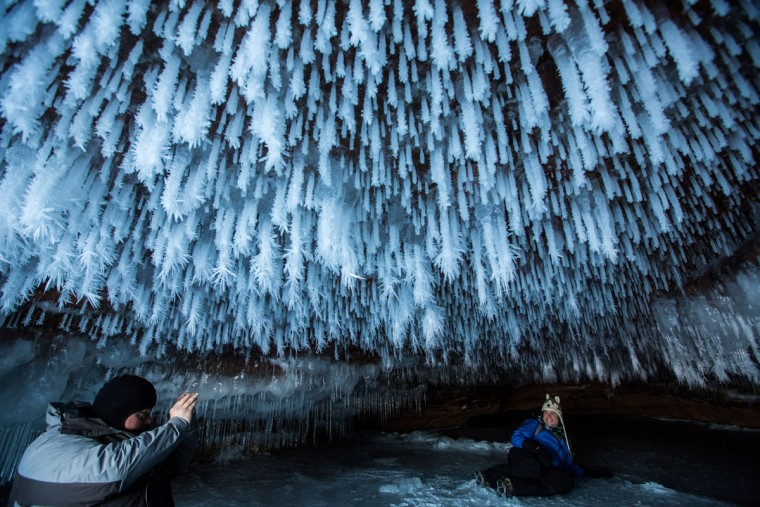 James Kuhn, left, of Seattle, and Edward Mitchell, of Detroit, explore an ice cave at the Apostle Islands National Lakeshore on Lake Superior, Friday, Feb. 27, 2015, near Bayfield, Wis. (Zbigniew Bzdak/Chicago Tribune)
