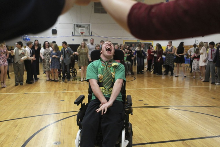 William Marlene, 21, moves across the dance floor Tuesday, March 17, 2015, during the We Not Me Ball at Enterprise High School in Redding, Calif. Student leaders put on the prom for the special needs students at the school. (AP Photo/The Record Searchlight, Andreas Fuhrmann)