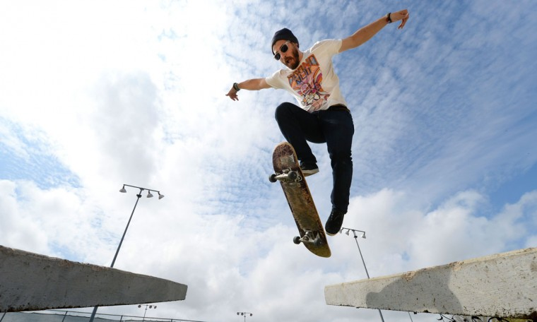 Josh Hurt extends out his arms while performing a skateboard trick over a gap at the G. Hysmith Skate Park in College Station, Texas on Thursday, March 19, 2015. (AP Photo/The Bryan-College Station Eagle, Sam Craft)