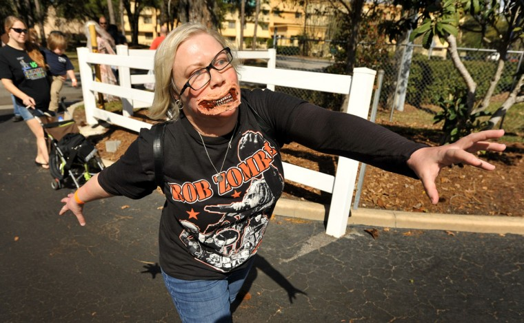 Zombie Walk participant Susan Harrington from St. Simons Island, Georgia gives her all during Zombie Walk, part of the day's Retr-O-Rama event in Jacksonville, Fla., Sunday, Feb. 8, 2015 Comic book and vintage toy fans worked their way through the displays at Sunday's Retr-0-Rama Collectible Show as well as took part in a Zombie Walk outside the hotel and a costume contest inside. Among this year's celebrity guests was Lew Temple who plays Alex the convict in the series, Walking Dead. (AP PhotoThe Florida Times-Union, Bob Self)