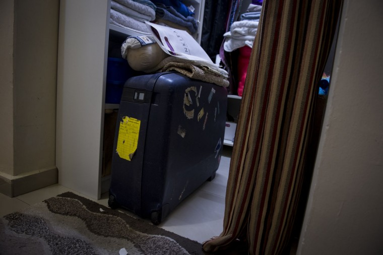 One of Patrick Gomes's luggage bags left untouched in his closet in his house outside Kuala Lumpur, Malaysia. Gomes, 56, was the in-flight supervisor aboard Malaysian Airlines flight 370 when it disappeared last March. (AP Photo/Joshua Paul)