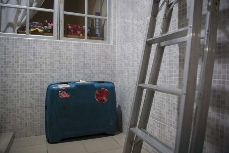 """A luggage bag belonging to Foong Wai Yueng, 40, a stewardess who was aboard Malaysian Airlines flight 370 when it disappeared last March, at her home in Kuala Lumpur, Malaysia. Yueng's husband, Lee Khim Fatt, 45, asked a friend to return the bag to him from the hotel where the Malaysia Airlines crew would stay in Beijing. Fatt says """"her belongings are meant to be home and not missing somewhere."""" Fatt says he tried to open the bag but unfortunately, didn't know the pin code. (AP Photo/Joshua Paul)"""