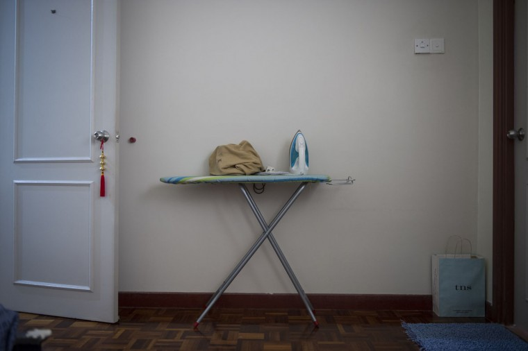 The ironing board and iron of David Tan Size Hiang, 47, a flight attendant aboard MH370 in his house outside Kuala Lumpur, Malaysia. Hiang's wife said he used to iron before going to work. (AP Photo/Joshua Paul)