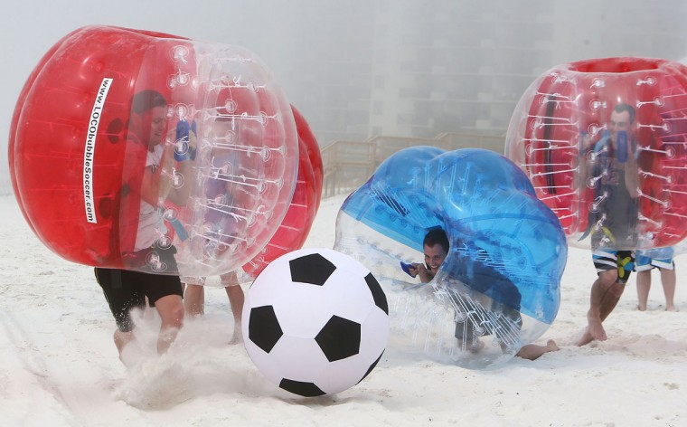 Spring breakers play bubble soccer in Panama City Beach, Fla., on Tuesday, March 3, 2015. (AP Photo/The News Herald, Andrew Wardlow)