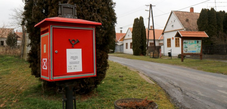 A mailbox stands besides of one of the four streets in the village of Megyer, Hungary, Friday March 13, 2015. For 210,000 forints (US Dollar 730) a day, visitors get access to seven guest houses in the village that sleep 39 people, a bus stop, horses, chickens and four hectares (10 acres) of farm land. (AP Photo/Ronald Zak)