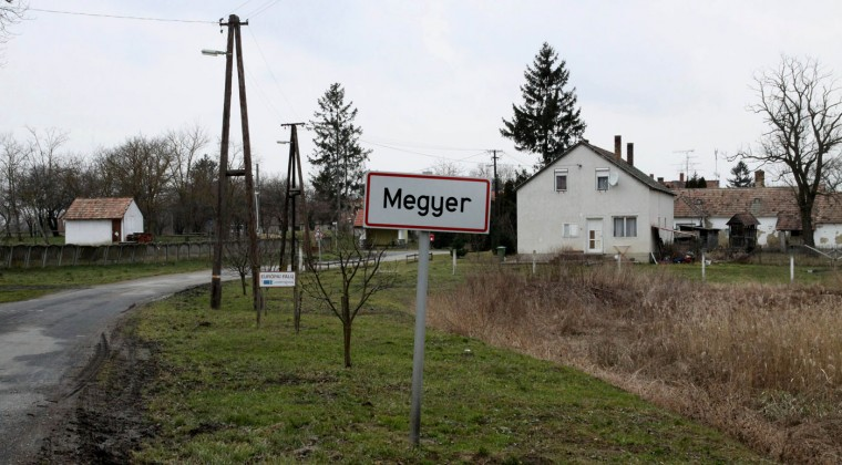 A signpost at the entrance to the village of Megyer, Veszprem county, 190 kilometers southwest of Budapest, Hungary, Wednesday, Feb. 25, 2015. The village of Megyer, population 18, has put itself up for rent to companies and tourists. For 210,000 forints ($750; 690 euro) a day, a prospective renter gets seven guesthouses that sleep 39 people, four streets, a bus stop, a barn, a chicken yard, six horses, two cows, three sheep and four hectares (10 acres) of farmland - along with the possibility of temporarily being named deputy mayor. (AP Photo/MTI, Lajos Nagy)