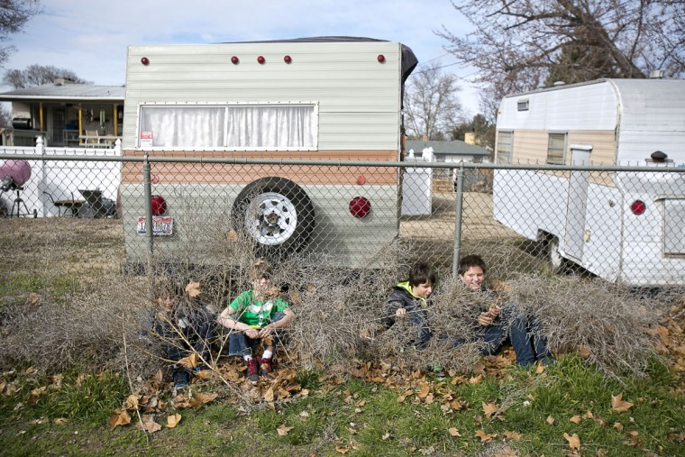 Sixth-grade students at Owyhee-Harbor Elementary School in Boise, Idaho play hide and seek during lunch recess Friday, Feb. 27, 2015. (AP Photo/The Idaho Statesman, Kyle Green)