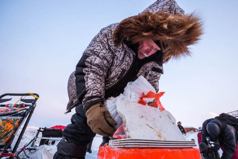 Jeff King mixes dog food in the Unalakleet checkpoint in the Iditarod on Sunday, March 15, 2015. Aaron Burmeister, 39, was the first musher to reach Unalakleet, the first checkpoint on the Bering Sea coast. (AP Photo/Alaska Dispatch News, Loren Holmes)