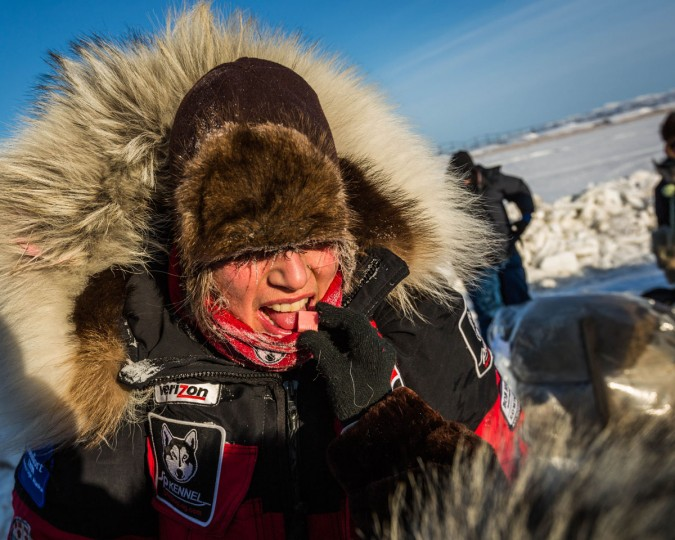 Aliy Zirkle gets fed a Starburst candy by Autumn Nanouk, 9, at the Unalakleet checkpoint in the Iditarod on Sunday, March 15, 2015. Aaron Burmeister, 39, was the first musher to reach Unalakleet, the first checkpoint on the Bering Sea coast. (AP Photo/Alaska Dispatch News, Loren Holmes)
