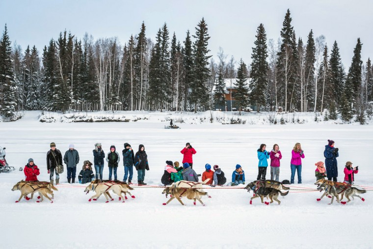 University Park sixth graders cheer on musher Kristy Berington during the start of the Iditarod Trail Sled Dog Race, Monday, March 9, 2015, in Fairbanks, Alaska. Iditarod mushers began their 1,000-mile trek across Alaska along a new route Monday after poor trail conditions forced organizers to push the race's start north, bypassing a mountain range. (AP Photo/Alaska Dispatch News, Loren Holmes)