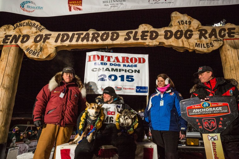 Dallas Seavey, the 2015 Iditarod Trail Sled Dog Race champion, poses with his lead dogs Reef, left, and Hero in Nome, Alaska on Wednesday, March 18, 2015. Seavey won his third Iditarod in the last four years, beating his father, Mitch, to the finish line after racing 1,000 miles across Alaska. (AP Photo/Alaska Dispatch News, Loren Holmes)