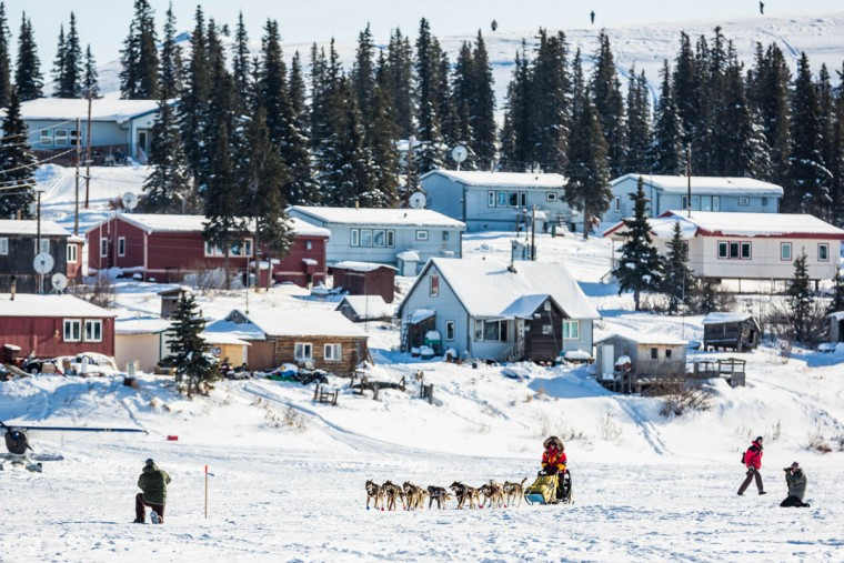 Mitch Seavey mushes into White Mountain during the Iditarod Trail Sled Dog Race on Tuesday, March 17, 2015. Dallas Seavey has won his third Iditarod in the last four years, beating his father, Mitch, to the finish line in Nome early Wednesday after racing 1,000 miles across Alaska. (AP Photo/Alaska Dispatch News, Loren Holmes )