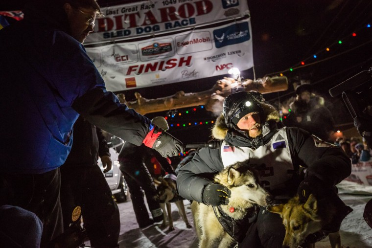 Dallas Seavey is interviewed with his lead dogs Hero, left, and Reef in Nome, Alaska on Wednesday, March 18, 2015 during the Iditarod Trail Sled Dog Race. Seavey won his third Iditarod in the last four years, beating his father, Mitch, to the finish line after racing 1,000 miles across Alaska. (AP Photo/Alaska Dispatch News, Loren Holmes)