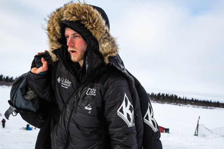 Dallas Seavey, who arrived first into the White Mountain, Alaska checkpoint, walks from the dog yard to the checkpoint on Tuesday, March 17, 2015 during the Iditarod Trail Sled Dog Race. Seavey has won his third Iditarod in the last four years, beating his father, Mitch Seavey to the finish line in Nome early Wednesday after racing 1,000 miles across Alaska. (AP Photo/Alaska Dispatch News, Loren Holmes)
