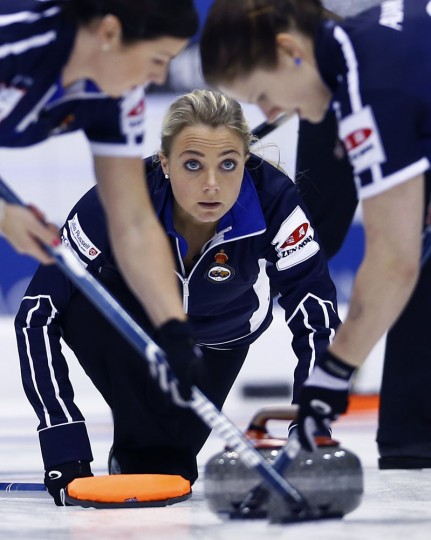 Scotland's Anna Sloan, center, watches after releasing the rock as her team plays Russia in the first end during their match for bronze medal at the World Women's Curling Championships in Sapporo, northern Japan, Sunday, March 22, 2015. (AP Photo/Shizuo Kambayashi)