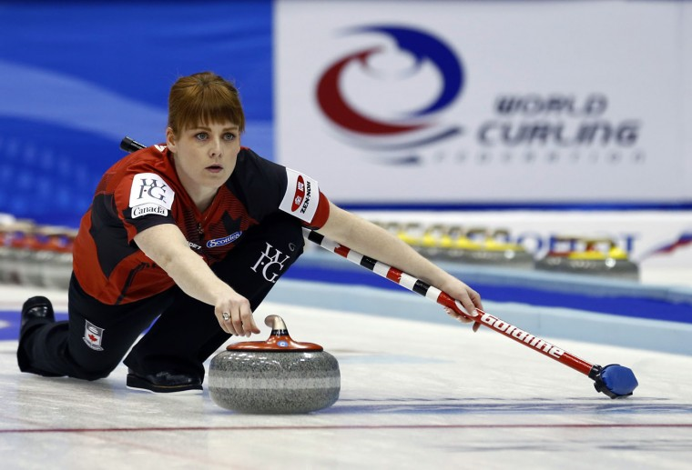 Canada's lead Dawn McEwen delivers a stone as the team plays Russia during the 9th end of a semi-final match at the women's World Curling Championships in Sapporo, northern Japan, Saturday, March 21, 2015. (AP Photo/Shizuo Kambayashi)