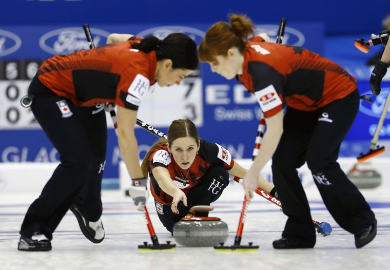 Canada's third Kaitlyn Lawes, center, watches after releasing the rock as the team plays Russia during the 9th end of their semifinal match of the women's World Curling Championships in Sapporo, northern Japan, Saturday, March 21, 2015. (AP Photo/Shizuo Kambayashi)