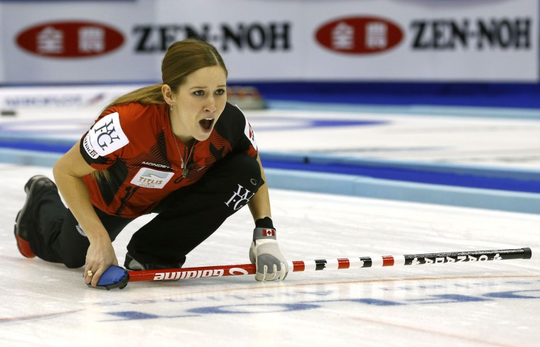 Canada's Kaitlyn Lawes yells as her team plays Russia during the fourth end of semi-finals during the women's World Curling Championships in Sapporo, northern Japan, Saturday, March 21, 2015. (AP Photo/Shizuo Kambayashi)