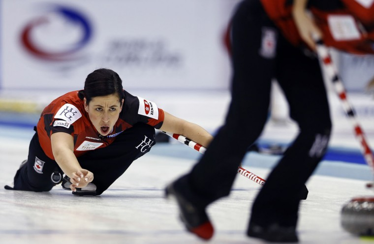 Canada's second Jill Officer yells as the team plays Russia during the fourth end of their semifinal match at the women's World Curling Championships in Sapporo, northern Japan, Saturday, March 21, 2015. (AP Photo/Shizuo Kambayashi)