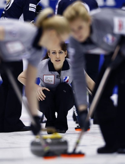 Russia's Ekaterina Galkina, center, watches after releasing the rock in the first end during their match against Scotland for bronze medal at the World Women's Curling Championship in Sapporo, northern Japan, Sunday, March 22, 2015. (AP Photo/Shizuo Kambayashi)