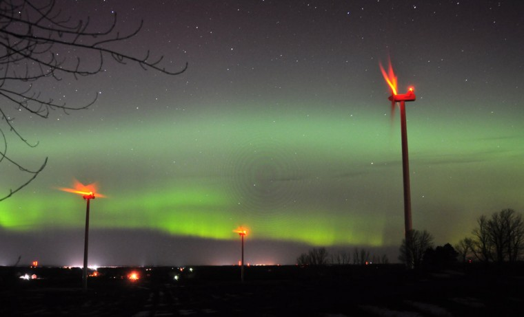 The wind turbines of Consumers Energy's Lake Winds Energy Park operate as the Northern Lights appear over Ludington, Mich., late Tuesday, March 17, 2015. (AP Photo/Ludington Daily News, Steve Begnoche)