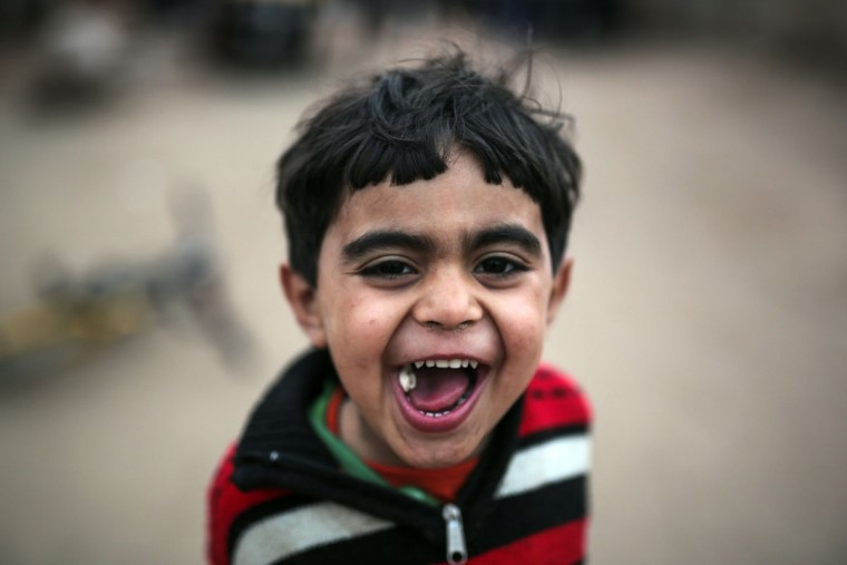 Hazem, 5, poses for a portrait in Geziret Al-Warraq, an impoverished island that can only be reached by ferry, in Cairo, Egypt, Tuesday, March 10, 2015. (AP Photo/Mosa'ab Elshamy)
