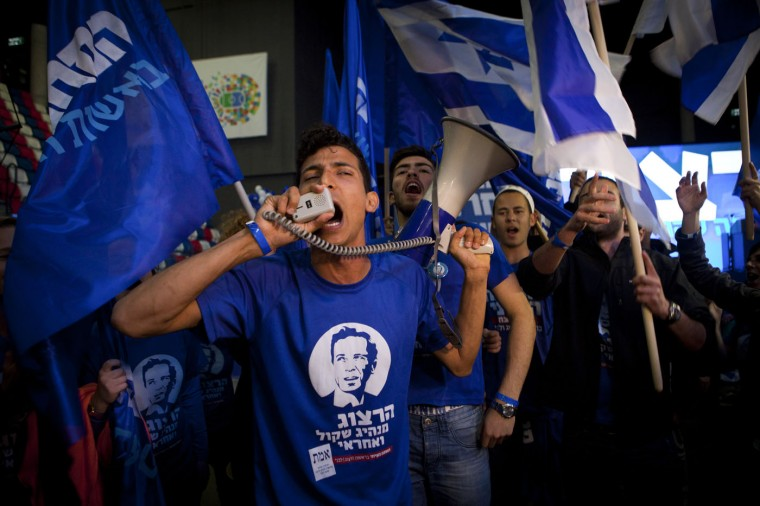 Zionist Union party supporters cheer at the party's election headquarters In Tel Aviv.Tuesday, March 17, 2015. Israelis are voting in early parliament elections following a campaign focused on economic issues such as the high cost of living, rather than fears of a nuclear Iran or the Israeli-Arab conflict. (AP Photo/Dan Balilty)