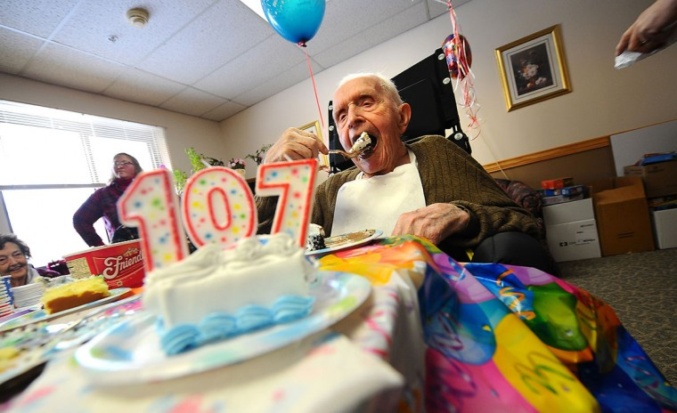 Floyd Eastman, 107 years-old, celebrates his birthday at the Orchard Nursing Home in North Granville, NY, Friday, Feb. 6, 2015. (AP Photo /Post Star, Steve Jacobs)