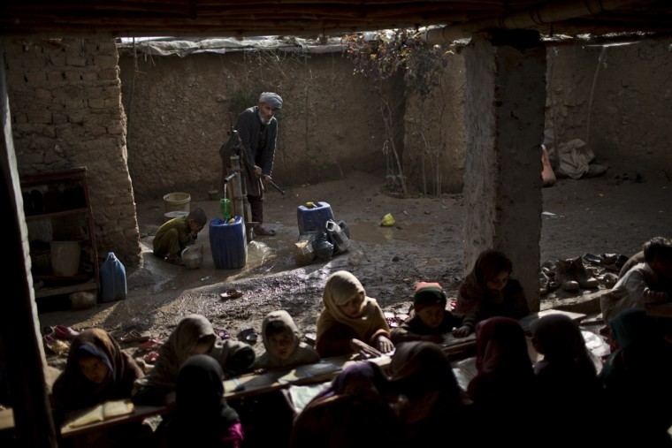 In this Saturday, Feb. 21, 2015, photo, a boy washes himself before joining other internally displaced Pakistani children from tribal areas attending madrassa, or Islamic school, set up in a mosque on the outskirts of Islamabad, Pakistan. Thereís no exact number of madrassas in Pakistan but estimates put the number in the tens of thousands. They provide food, housing and a religious education to students from around the country. (AP Photo/Muhammed Muheisen)