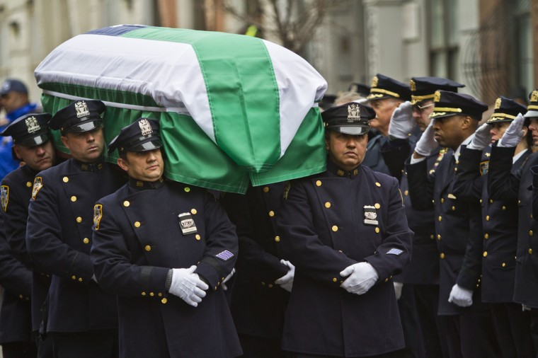Pallbearers from the NYPD ceremonial unit carry the casket of NYPD Det. Paul Duncan after funeral services at Abyssinian Baptist Church, Wednesday, March 4, 2015, in Harlem, N.Y. Det. Duncan, of Hartsdale, was killed off-duty Feb. 27 on the Sprain Brook Parkway in Greenburgh, N.Y., when a vehicle traveling the wrong way hit his SUV head-on. (AP Photo/Bebeto Matthews)