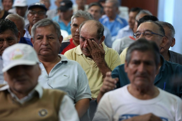 In this Feb. 27, 2015 photo, 69-year-old Sergio del Carpio is moved to tears while listening to a Peruvian folk song at the Lurigancho men's prison in Lima, Peru. Carpio, who is serving a five year sentence, was convicted of vehicular homicide for killing a man while driving drunk. (AP Photo/Martin Mejia)