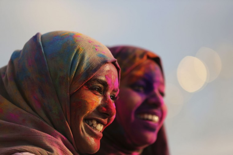 Women with colored powder on their face joins celebrations of the Holi festival in suburban Pasay, south of Manila, Philippines, on Sunday, March 1, 2015. The event is led by Indian nationals as they mark Holi, a Hindu spring festival also known as festival of colors. (AP Photo/Aaron Favila)